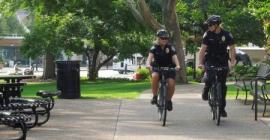 Two bicycle officers on campus